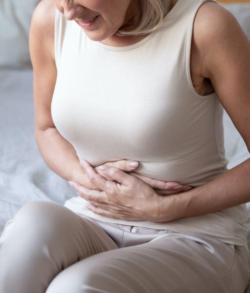 Woman undergoing intense pelvic pain